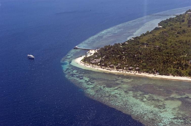 Aerial view of resort,houses, reef & Pelagian