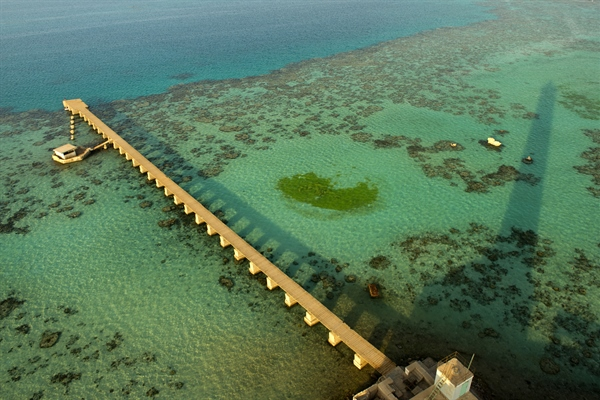 Colorful red sea reef and wharf aerial view