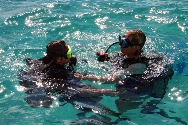 Divers doing the skills before a dive