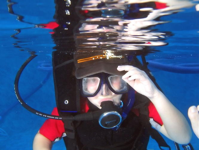 Child clearing a diving mask