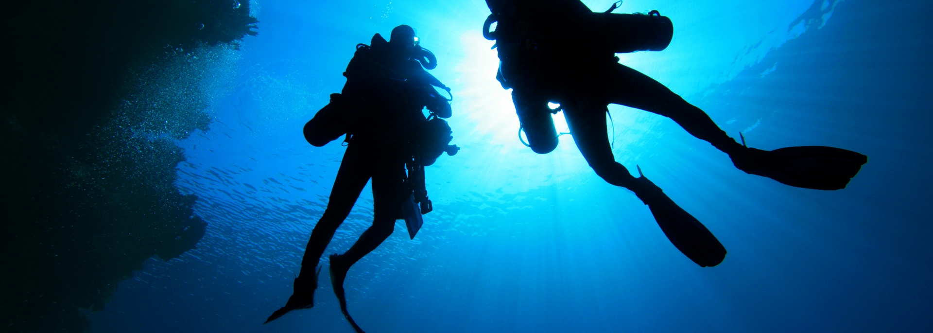 Divers in a Cave